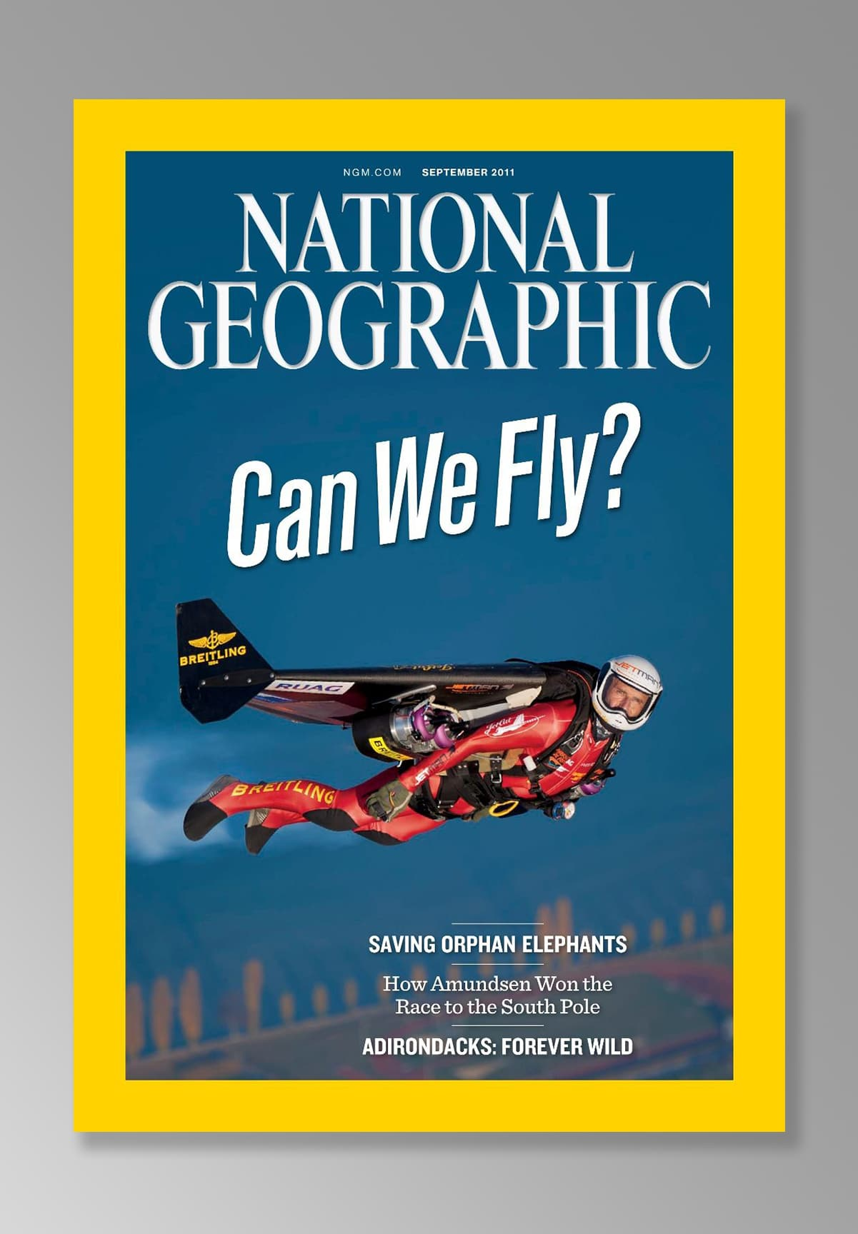 Jetman Yves Rossy dons the cover of National Geographic for a historical shot of his flight in Dubai