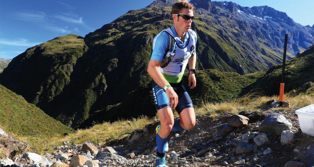 Sam Clark running up a mountain during a multisport race in NZ