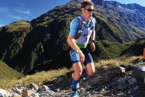 Sam Clark running up a mountain during a multisport race in NZ