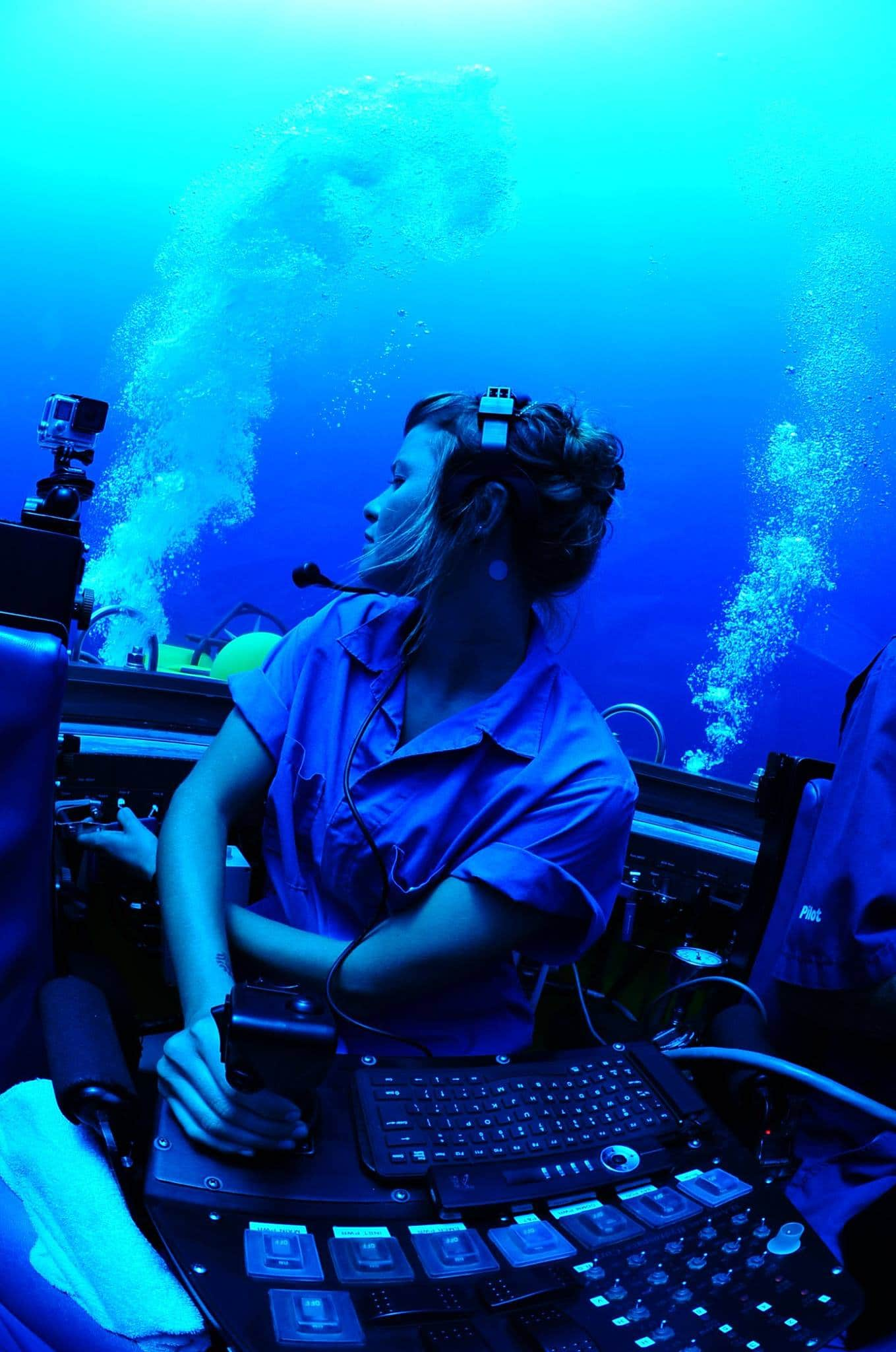Diana Garcia Benito inside a submarine pilotting it underwater